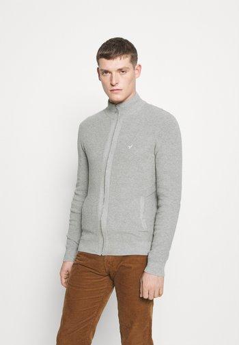 Neuletakki - mottled light grey