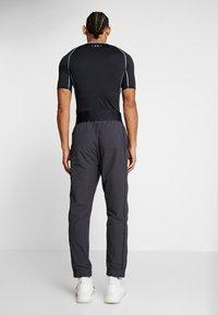 Calvin Klein Performance - TRACK PANTS - Spodnie treningowe - gunmetal/black - 2