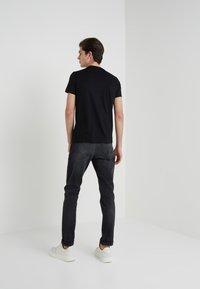 Emporio Armani - Camiseta estampada - black - 2