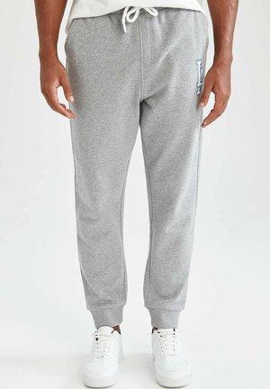 REGULAR FIT  - Tracksuit bottoms - grey