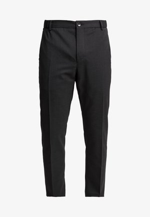 TRAVEL TAPERED PANT - Kangashousut - anthracite