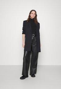 Deadwood - POPPY PANTS - Leather trousers - black - 1