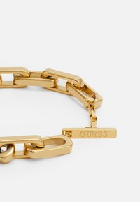 Guess - URBAN LEGEND T BAR LOGO BOLD CHAIN UNISEX - Pulsera - gold-coloured - 1