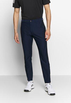 Spodnie materiałowe - collegiate navy