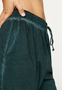 OYSHO - Tracksuit bottoms - dark blue - 5
