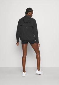 Nike Performance - RUN - Sports jacket - black/bright crimson - 2