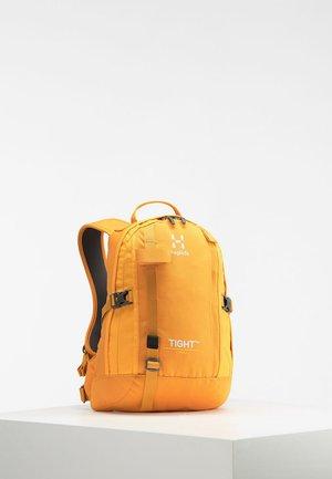 TIGHT X-SMALL - Hiking rucksack - desert yellow/cloudberry