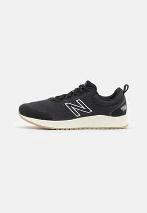 ARISHI - Neutral running shoes - black