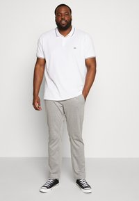 s.Oliver - Tracksuit bottoms - asche - 1
