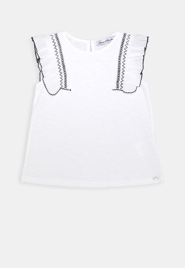 T-shirts med print - blanc