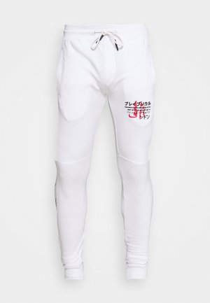 FIRE - Tracksuit bottoms - white