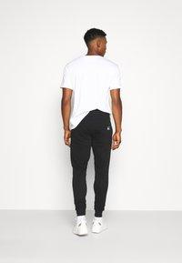 Redefined Rebel - LOGAN PANTS - Teplákové kalhoty - black - 2