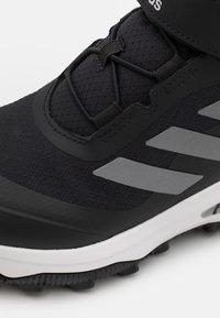 adidas Performance - FORTARUN ATR UNISEX - Obuwie hikingowe - core black/silver metallic/footwear white - 5