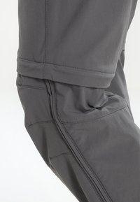 Vaude - WOMEN'S FARLEY STRETCH ZO T-ZIP PANTS 2-IN-1 - Trousers - iron - 7