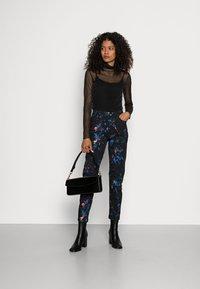 Desigual - PANT SPLATTER - Slim fit jeans - black - 1