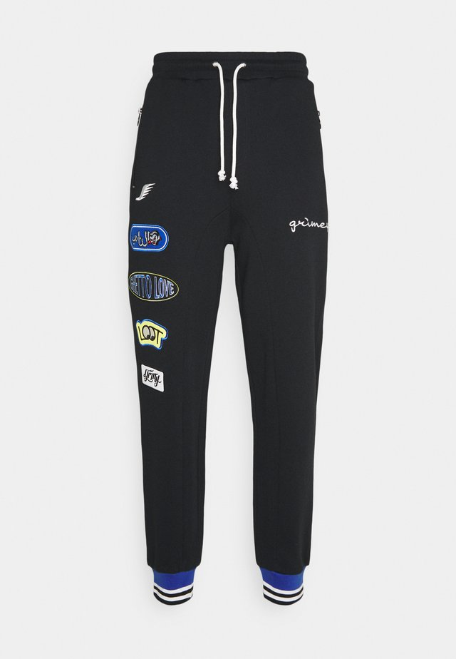 ARCH RIVAL UNISEX - Pantaloni sportivi - black