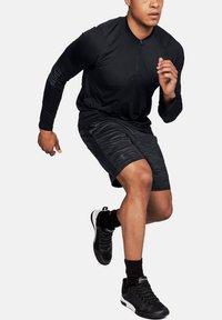 Under Armour - Sports shorts - black - 2