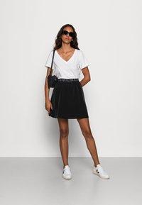 Calvin Klein Jeans - LOGO WAISTBANDSKIRT - Mini skirt -  black - 1