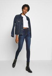 American Eagle - RISE JEGGING - Jeans Skinny Fit - blue denim - 1