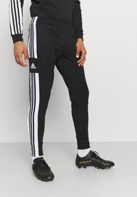 adidas Performance - SQUAD - Tracksuit bottoms - black/white - 0