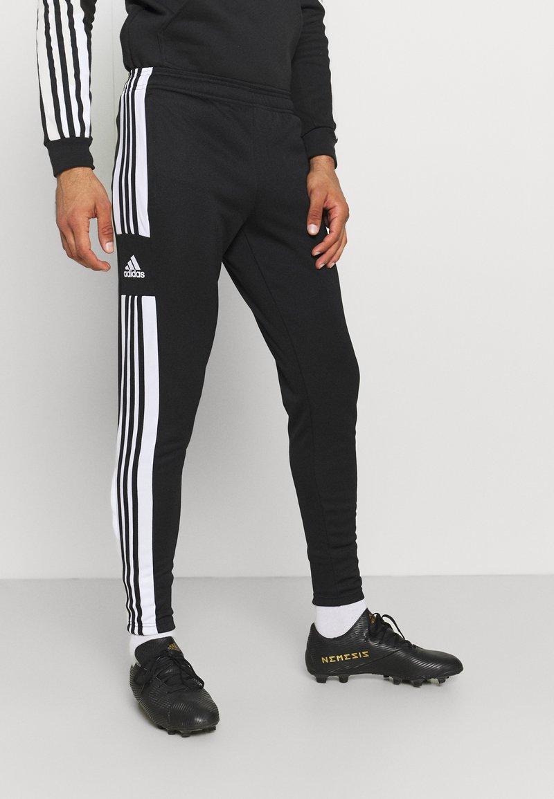 adidas Performance - SQUAD - Tracksuit bottoms - black/white
