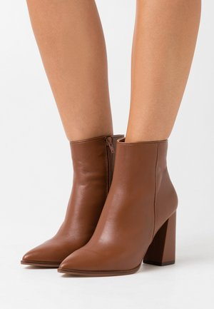 RAYNI - High heeled ankle boots - cognac
