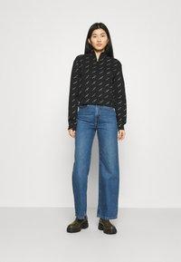 Calvin Klein Jeans - LOGO HALF ZIP - Felpa - black - 1