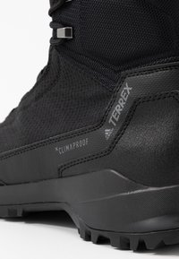 adidas Performance - TERREX FROZETRACK HIGH WINTER HIKING SHOES - Hiking shoes - core black/grey four - 5