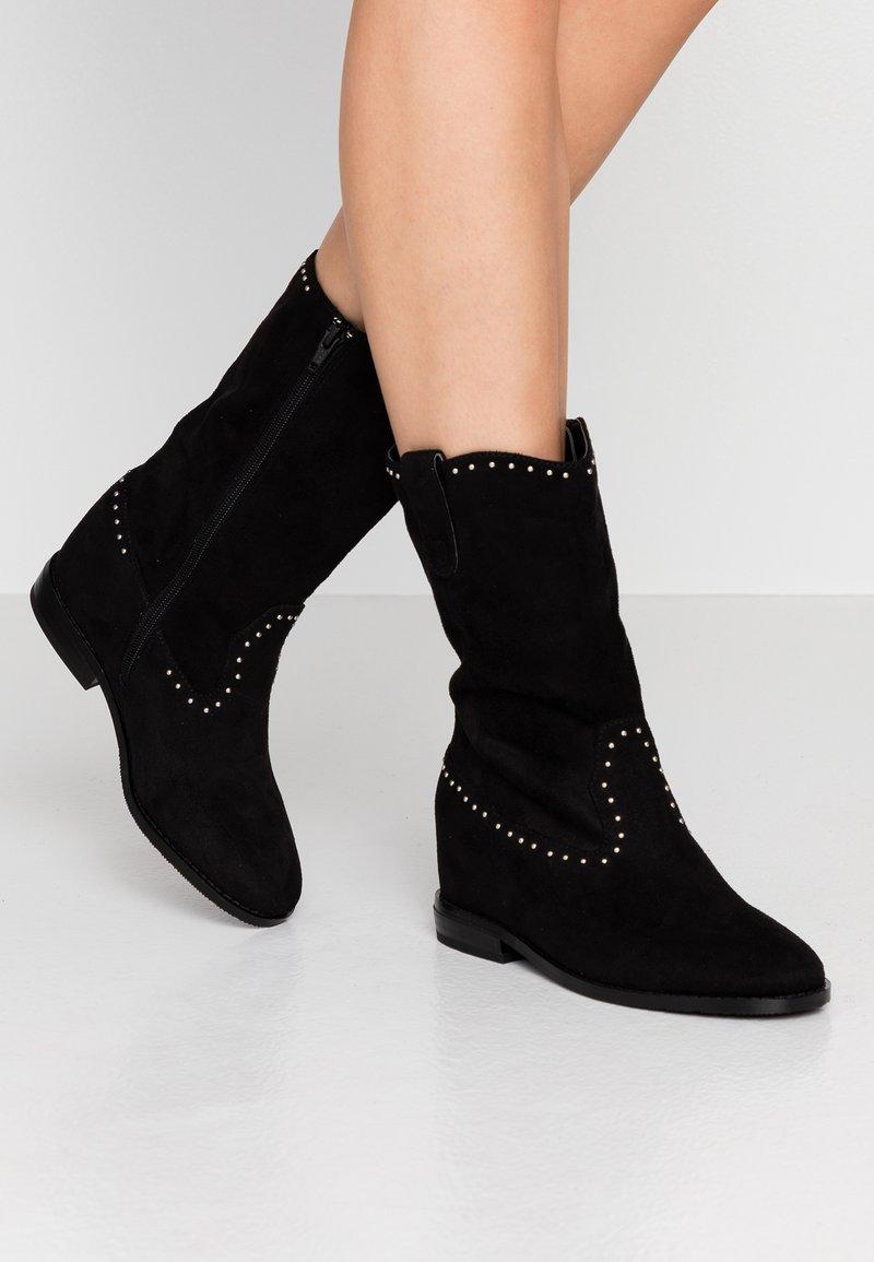 Tata Italia - Keilstiefel - black