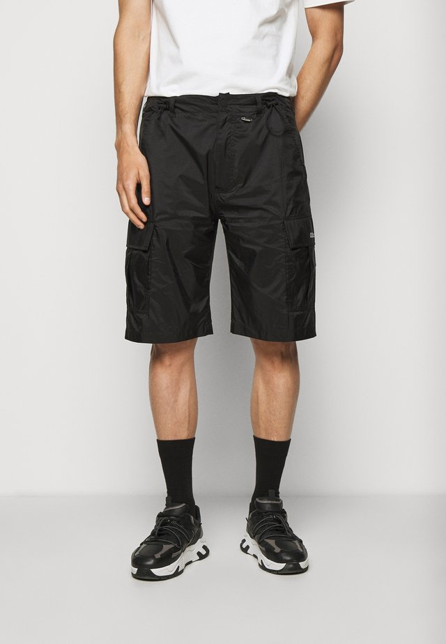 TRANSLUCENT CARGO - Shorts - black