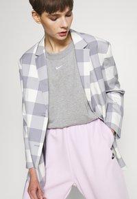 Nike Sportswear - Tracksuit bottoms - pink foam - 3