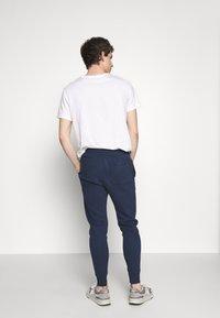 Abercrombie & Fitch - TECHNIQUE LOGO - Pantalones deportivos - navy - 2