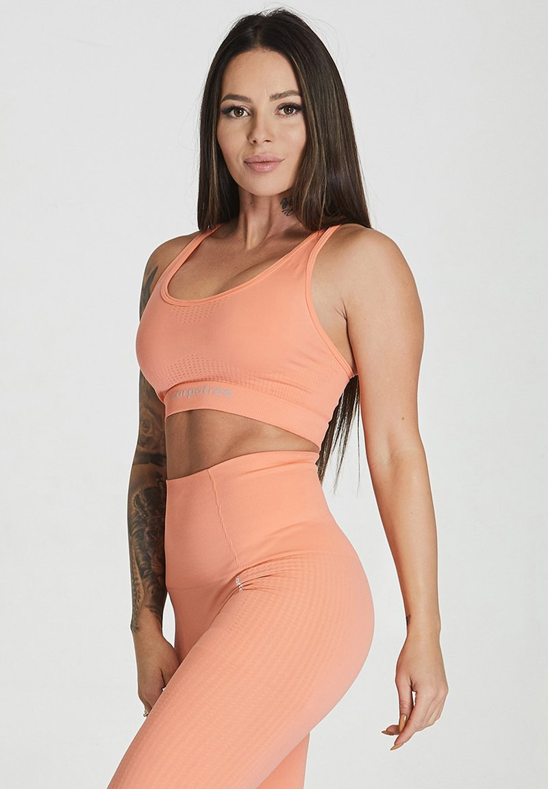 carpatree - ESSENTIAL SEAMLESS - Reggiseno sportivo - peach orange