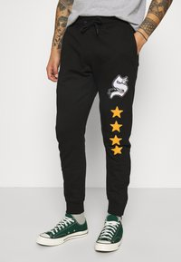 STAPLE PIGEON - UNISEX - Tracksuit bottoms - black - 0