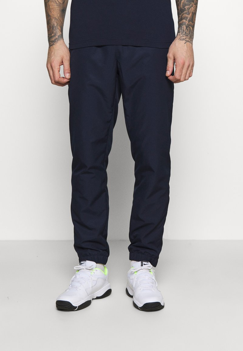 Lacoste Sport - TENNIS PANT TAPERED - Träningsbyxor - navy blue/white
