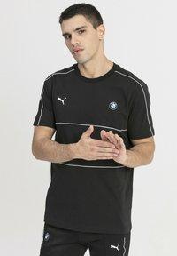 Puma - T-shirt med print - black - 0