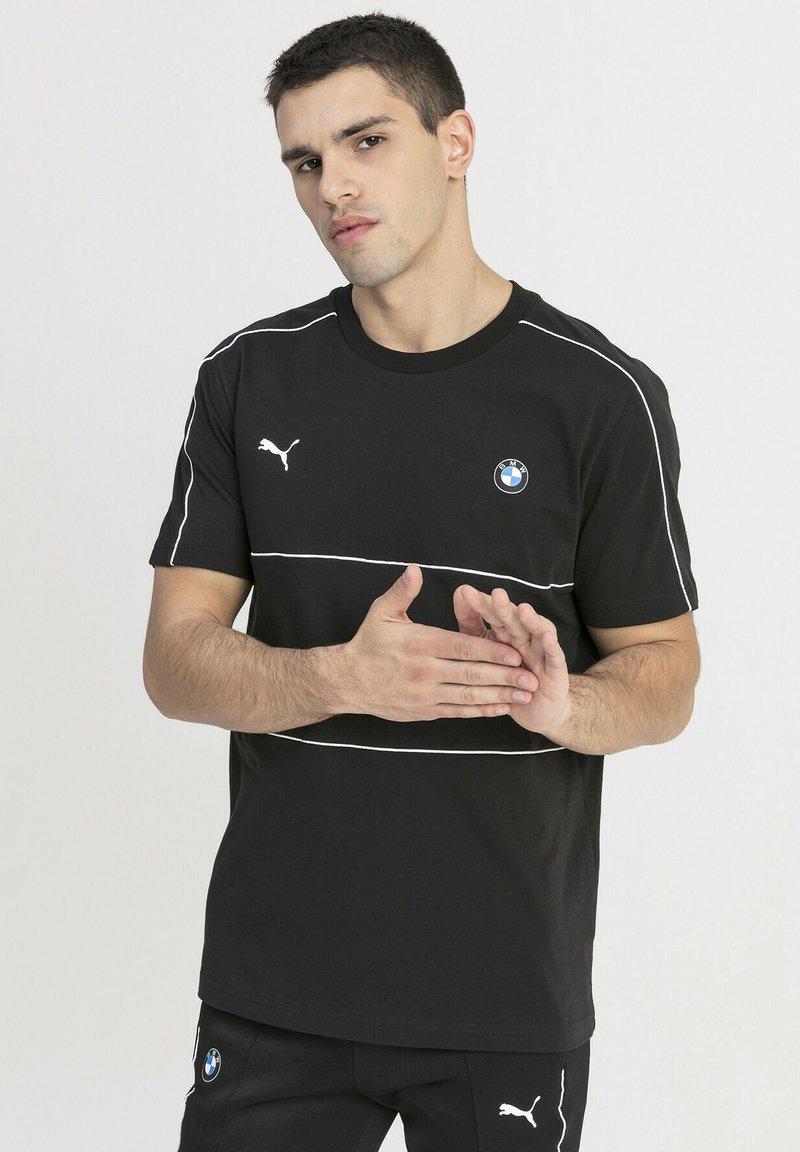 Puma - T-shirt med print - black