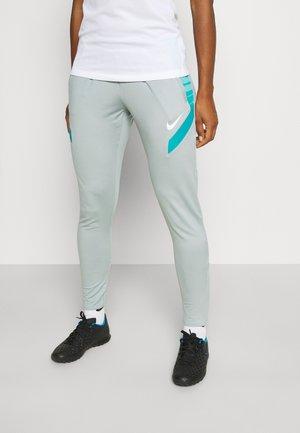STRIKE21 PANT - Spodnie treningowe - light pumice/tropical twist/white