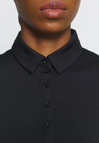 Under Armour - ZINGER SHORT SLEEVE - Polo shirt - black - 4