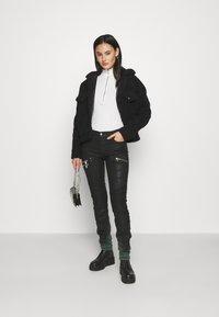 Diesel - D-OLLIES-BK-SP-NE JOGGJEANS - Slim fit jeans - black - 1