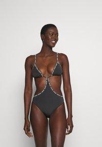 Calvin Klein Swimwear - CORE LOGO TAPE CUT OUT ONE PIECE - Plavky - black - 0