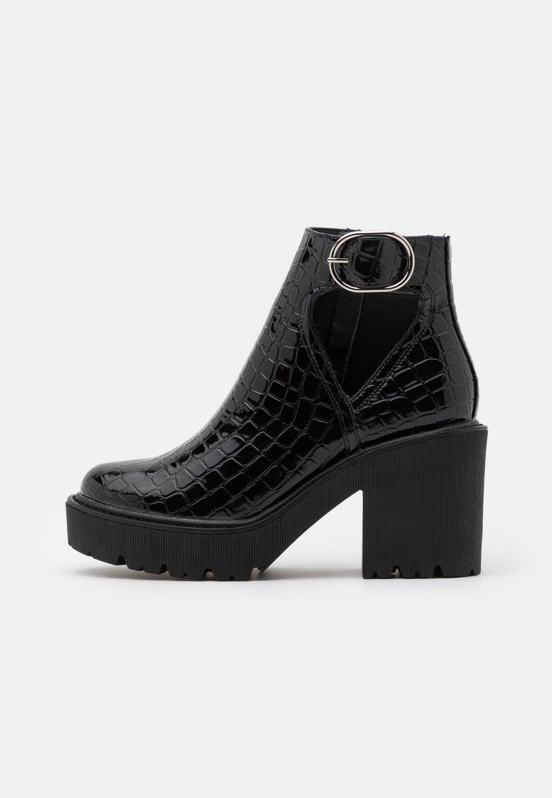Topshop - BRYCE CUT OUT UNIT - Platform ankle boots - black