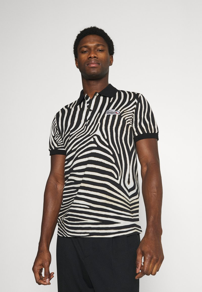 Lacoste - LACOSTE X NATIONAL GEOGRAPHIC - Polo shirt - black/white