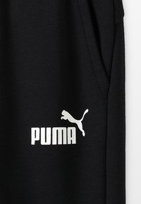 Puma - LOGO PANTS - Jogginghose - black - 4