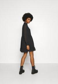 Tommy Jeans - TIERED LINE DRESS - Shirt dress - black - 2