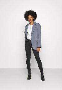Lee - SCARLETT BODY OPTIX - Jeans Skinny Fit - black denim - 1