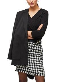 s.Oliver BLACK LABEL - MIT CACHE-COEUR-AUSSCHNITT - Long sleeved top - black - 4