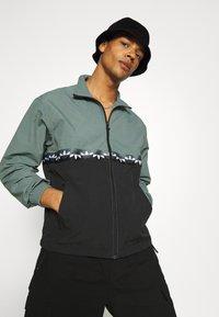 adidas Originals - SLICE - Training jacket - black/blue oxide - 3
