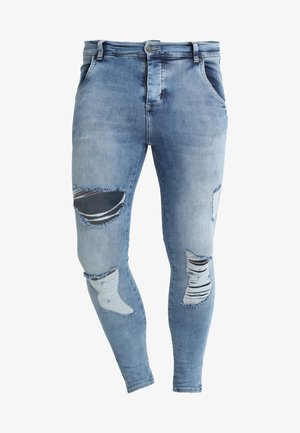 DISTRESSED SUPER  - Skinny-Farkut - mid wash denim