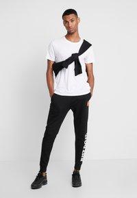 Nike Sportswear - PANT - Træningsbukser - black - 1
